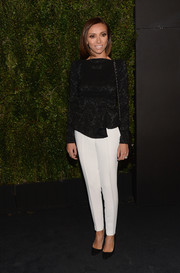 Giuliana Rancic looked conservative in a long-sleeve black peplum top during Drew Barrymore's book release party.