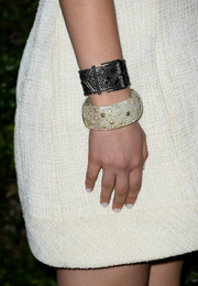 Odeya Rush wore two cuff bracelets to the Chanel pre-Oscar Soiree.