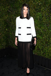 Crystal Renn was conservative up top in a loose black-and-white blouse during the Chanel and Charles Finch pre-Oscar dinner.
