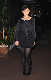 Ginnifer Goodwin finished her monochromatic look with black satin T-strap Summer pumps.