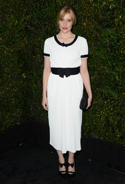 Greta Gerwig exuded retro charm in a monochrome Chanel dress with a bowed waistband during the Chanel and Charles Finch pre-Oscar dinner.