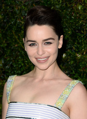 Emilia Clarke teased her locks into an elegant pompadour for the Chanel and Charles Finch pre-Oscar dinner.