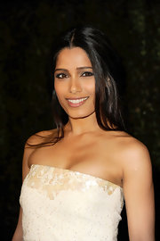Freida Pinto attended the Chanel and Charles Finch pre-Oscar Dinner wearing her long shiny locks sleek and straight.