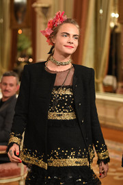 Cara Delevingne dazzled in a sequined jacket and a matching dress at the Chanel Collection des Métiers d'Art show.