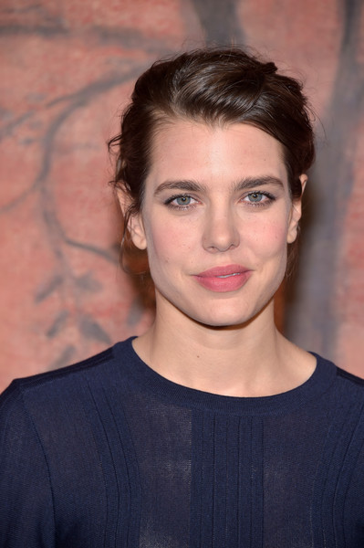 Charlotte Casiraghi wore her hair in a mildly messy updo at the Chanel Cruise photocall.