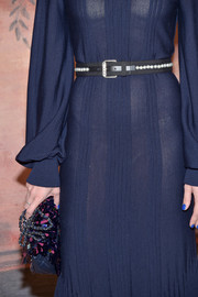 Charlotte Casiraghi styled her dress with a pearl-embellished belt for the Chanel Cruise 2017 show.