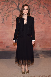 Keira Knightley layered a black Chanel tweed jacket over her dress for added sophistication.