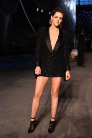 Kristen Steward styled her jacket with a pair of black lace booties by Alice McCall.