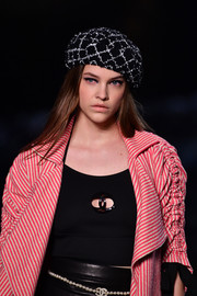 Barbara Palvin paired a grid-patterned beret with a striped coat for the Chanel Cruise runway show.