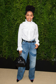 Yara Shahidi styled her look with a quilted black backpack by Chanel.