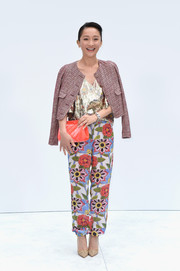 Zhou Xun attended the Chanel Couture show wearing a classic cropped tweed jacket slung over her shoulders.