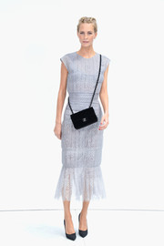 Poppy Delevingne showed full support for the brand by pairing her dress with a black Chanel chain-strap bag.