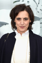 Ines de la Fressange sported a messy short hairstyle at the Chanel Couture Spring 2015 show.