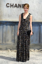 Rose Byrne looked effortlessly chic in a  button-print gown with black bow accents on the shoulders, which she wore to the Chanel Haute Couture show.
