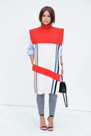 Miroslava Duma could certainly pull off menswear with flying colors, like she did at the Chanel Couture show with this ultra-modern turtleneck from the J.W. Anderson Fall 2014 menswear collection.