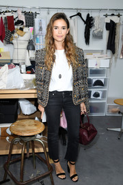 Miroslava Duma kept the rest of her look casual with a pair of black jeans and a white tee.