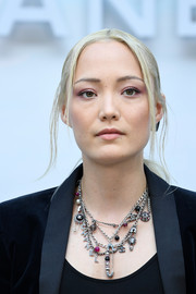 Pom Klementieff opted for a casual center-parted ponytail when she attended the Chanel Couture Fall 2018 show.