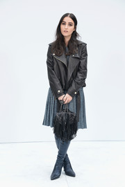 Jillian Banks toughened up a gray tweed dress with a black leather moto jacket for the Chanel Couture fashion show.