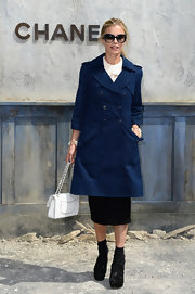 Laura Bailey wore a denim trench coat at the Chanel Haute Couture runway show.
