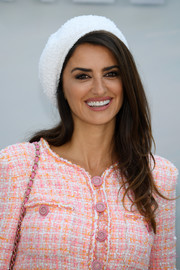 Penelope Cruz accessorized with a white beret for a touch of Parisian chic.