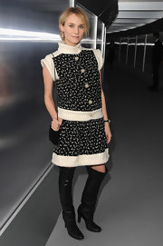 Diane topped off her Chanel dress with black leather over-the-knee boots.