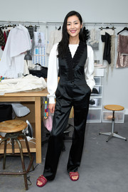 Liu Wen teamed a black ruffle jumpsuit with a white blouse for the Chanel Couture show.