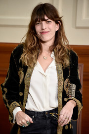 Lou Doillon looked opulent with her multiple rings and embellished velvet jacket at the Chanel fashion show.