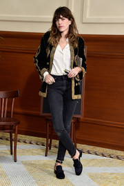 Lou Doillon suited up in an elegantly embroidered black jacket for the Chanel fashion show.