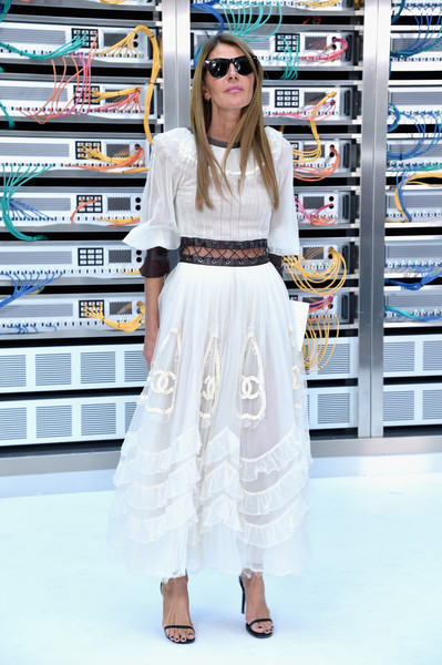 Anna dello Russo hovered between edgy and angelic in this floaty white Chanel dress with a midriff cutout and leather trim during the label's Spring 2017 show.