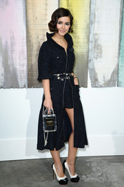 Miroslava Duma looked very cosmopolitan in a navy Chanel tweed coat during the brand's fashion show.