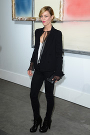 Vanessa Paradis paired a black double-breasted blazer with skinny jeans for an edgy-chic look during the Chanel fashion show.
