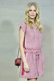 Poppy Delevingne showed full support for the French fashion house by donning this all-Chanel quilted bag and romper combo for its Spring/Summer 2015 show.