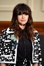 Miroslava Duma looked youthful and pretty with her tousled waves and eye-skimming bangs at the Chanel fashion show.