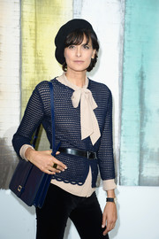 Ines de la Fressange completed her sophisticated ensemble with a blue leather shoulder bag when she attended the Chanel fashion show.