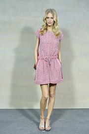 Poppy Delevingne chose a cute red and white printed romper by Chanel for the brand's Spring/Summer 2015 show.