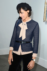 Ines de la Fressange's blue cardigan and pink tie-neck blouse at the Chanel fashion show were a very pretty pairing.