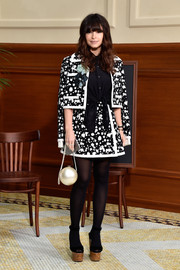 Miroslava Duma sported a black-and-white splatter-print skirt suit by Chanel during the label's fashion show.