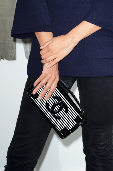Caroline De Maigret accessorized with a black-and-white striped Chanel purse during the label's fashion show.