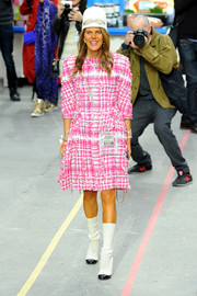 Anna dello Russo looked relatively low-key at the Chanel fashion show in a pink and white tweed dress from the brand.