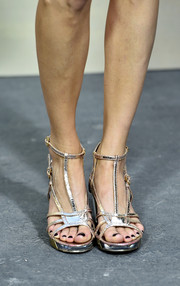 Poppy Delevingne wore metallic strappy sandals to the Chanel Spring/Summer 2015 show.