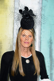 Anna dello Russo almost stole the show with this massive flower and mesh hat during the Chanel fashion show.