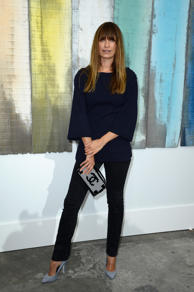 Caroline De Maigret went for subdued sophistication at the Chanel fashion show with a pair of black skinny jeans and a navy blouse with bell sleeves.