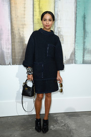 Zoe Kravitz chose a loose navy knit dress for the Chanel fashion show.