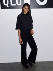 Chanel Iman covered up her slim figure in a loose black tee while attending a Uniqlo press event.