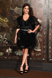 Penelope Cruz paired her top with a poofy black mini skirt, also by Chanel.
