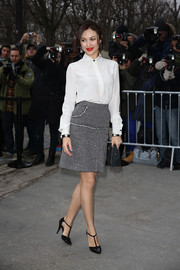 Olga Kurylenko completed her timeless look with a pair of black patent leather T-strap pumps.