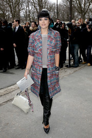 Lily Allen was punk-glam in a colorful Chanel tweed coat teamed with black leather pants during the label's fashion show.