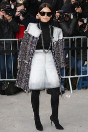 Miroslava Duma was winter-chic in a tweed coat and over-the-knee boots during the Chanel fashion show.