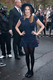 Ana Girardot topped off her blue tweed shift with black cap-toe Chanel ballet flats.