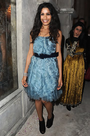Freida Pinto wore sky blue organza frock with a wide black leather belt for the Chanel Pre-Fall show in Paris.